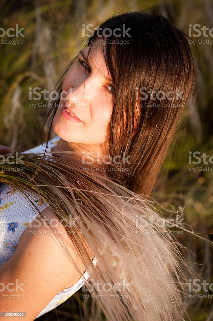 Woman with bouquet of feather-grass stock photo