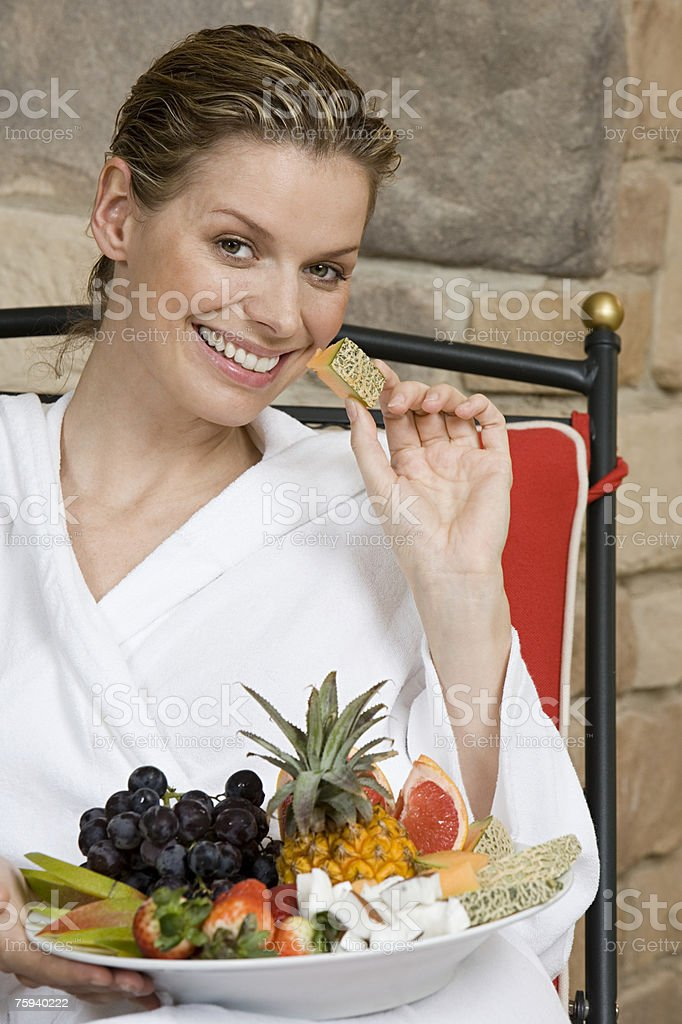 Woman with bowl of fruit royalty-free stock photo