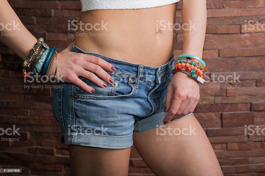 Woman with bracelets stock photo