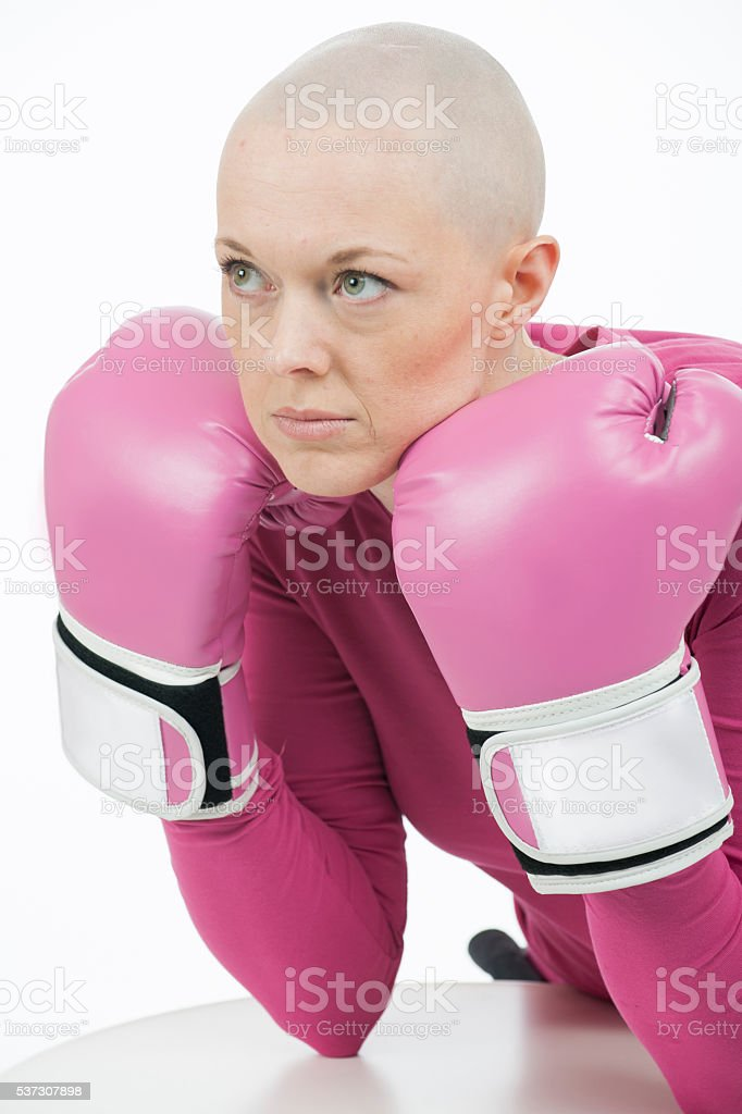 A woman with breast cancer has lost her hair due to stock photo