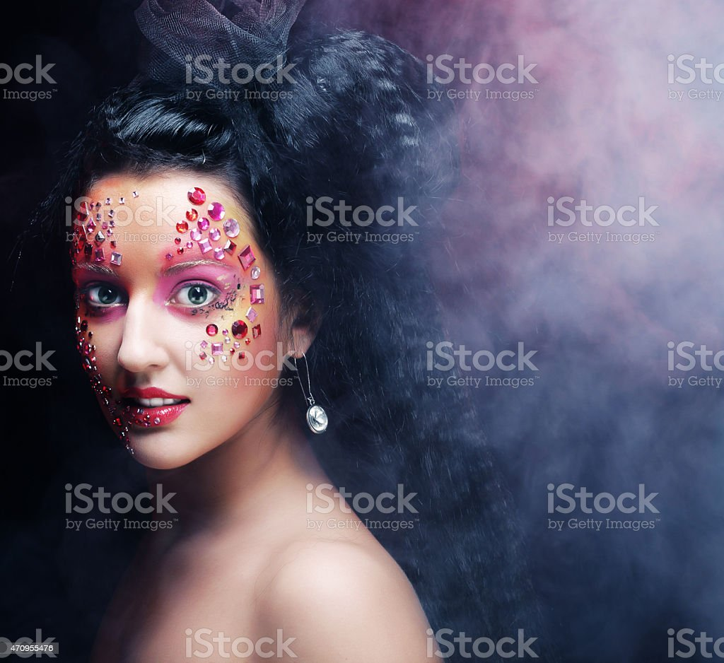 woman with bright artistic make-up stock photo