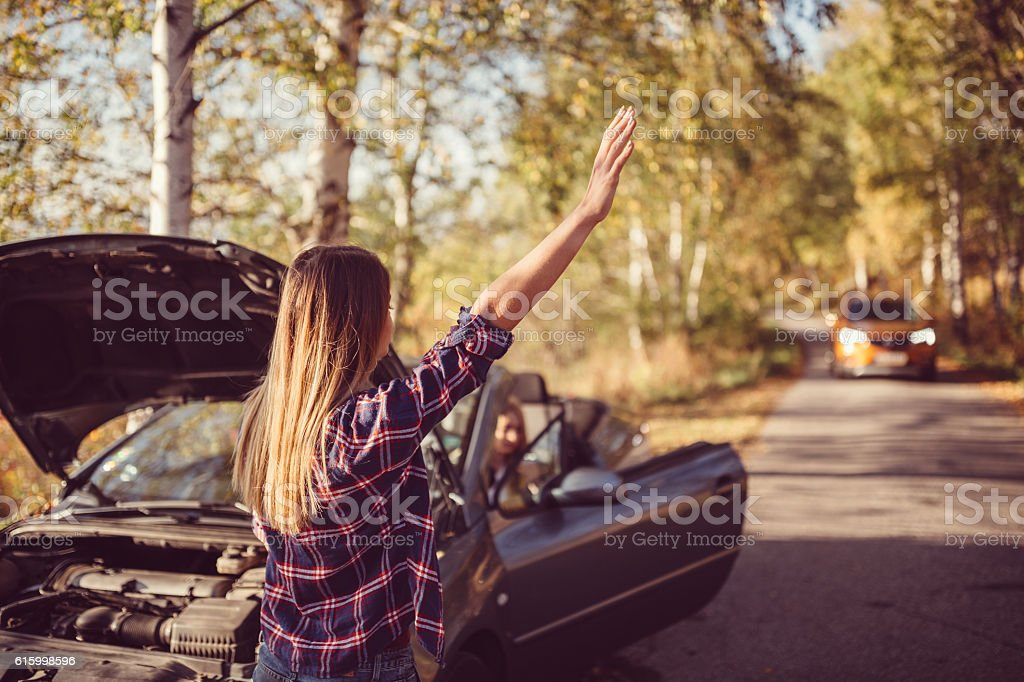 Woman with broken car on the road stock photo