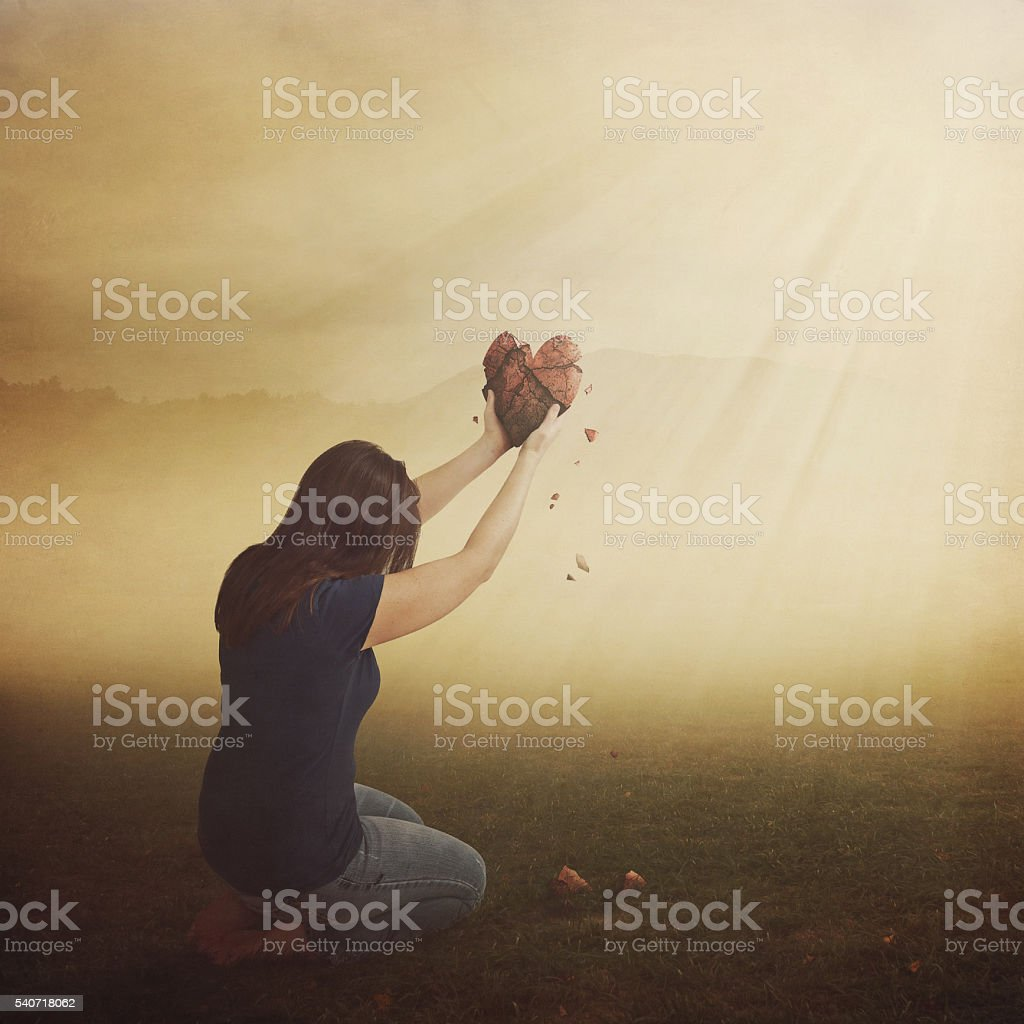 Woman with broken heart. stock photo