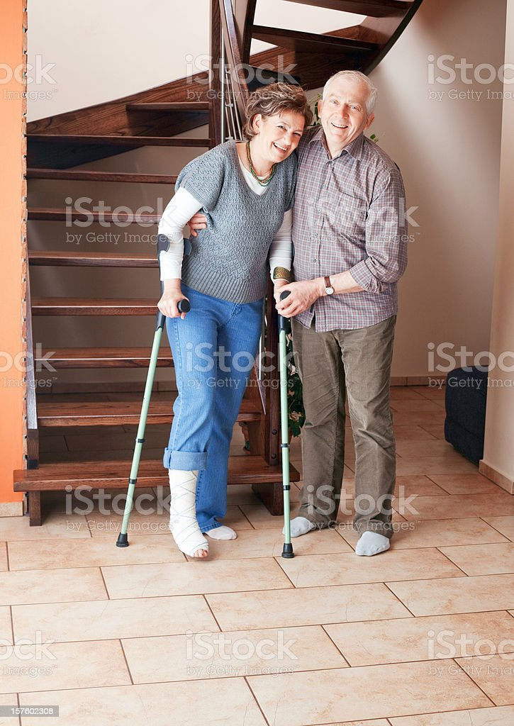 Woman with broken leg and crutches royalty-free stock photo