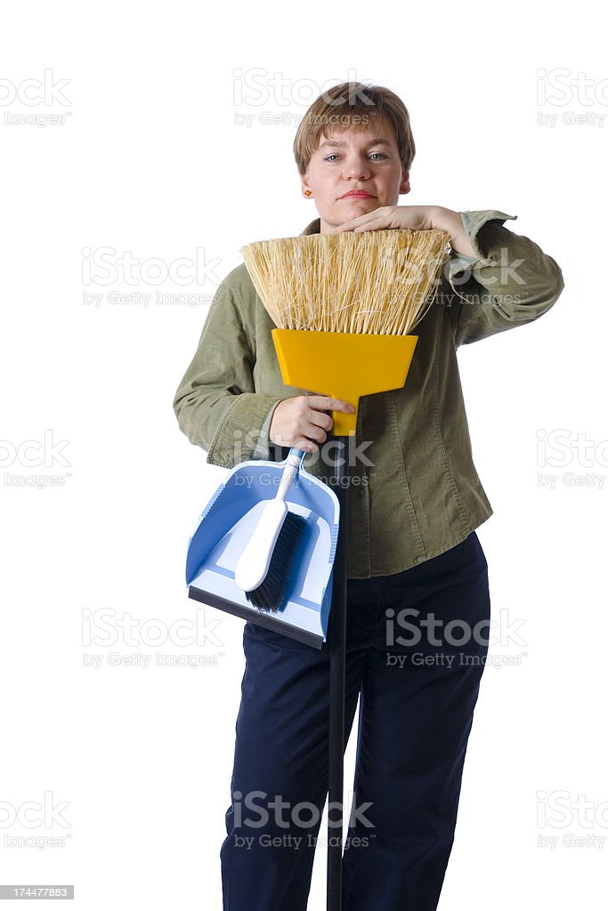 Woman with broom and dustpan stock photo