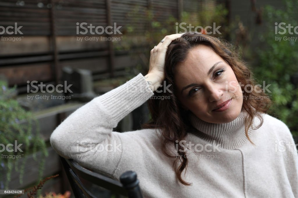 Woman with Brown Hair and Beautiful Brown Eyes stock photo