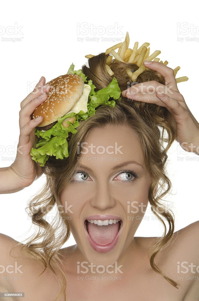 Woman with burger and fries shouts stock photo