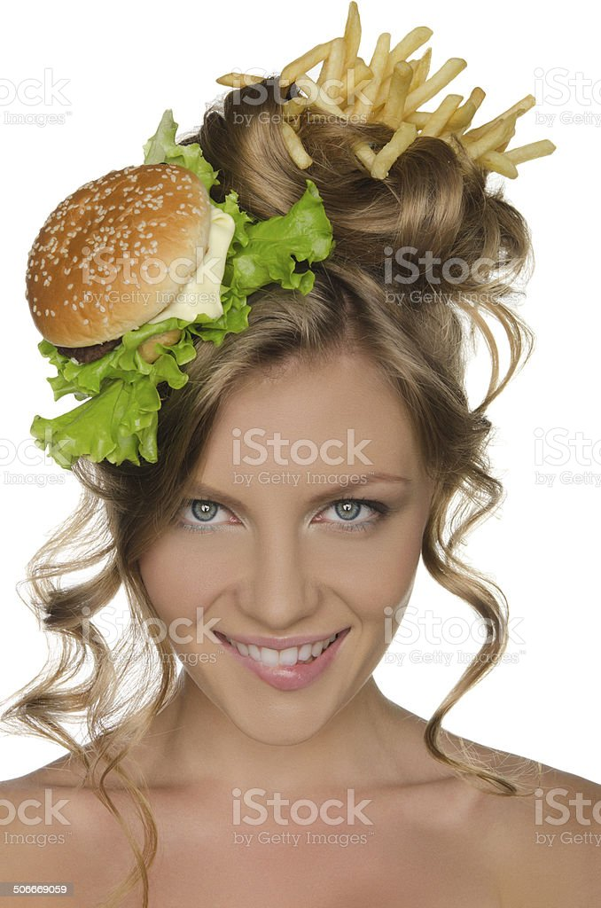 Woman with burger and fries smiling stock photo