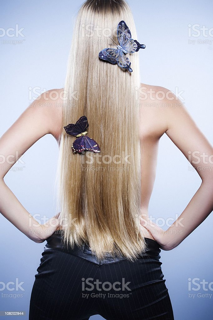 Woman with Butterflies in Hair royalty-free stock photo
