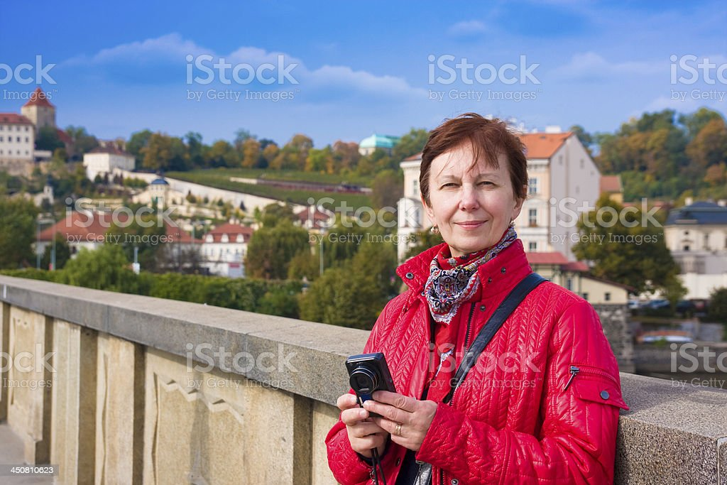 Woman with camera against Prague's sights royalty-free stock photo