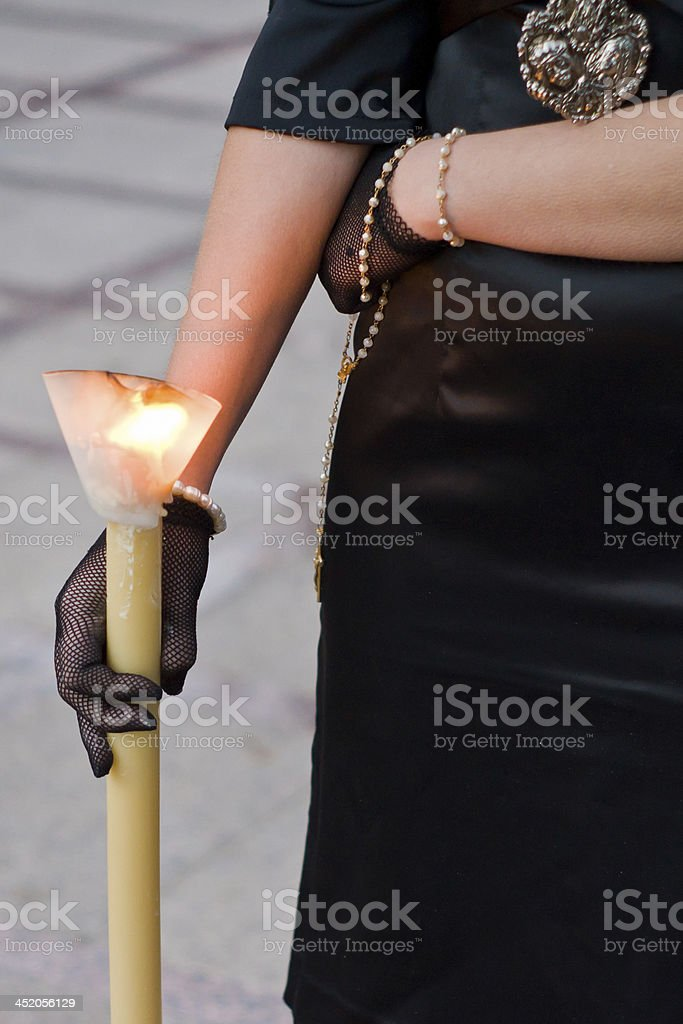 woman with candle Holy Week stock photo