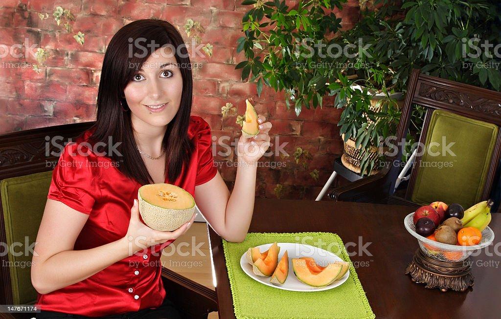 woman with cantaloup royalty-free stock photo