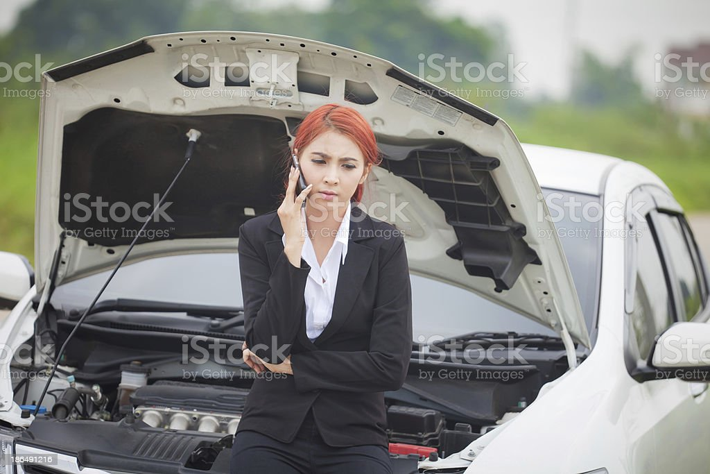 Woman with car broke down stock photo