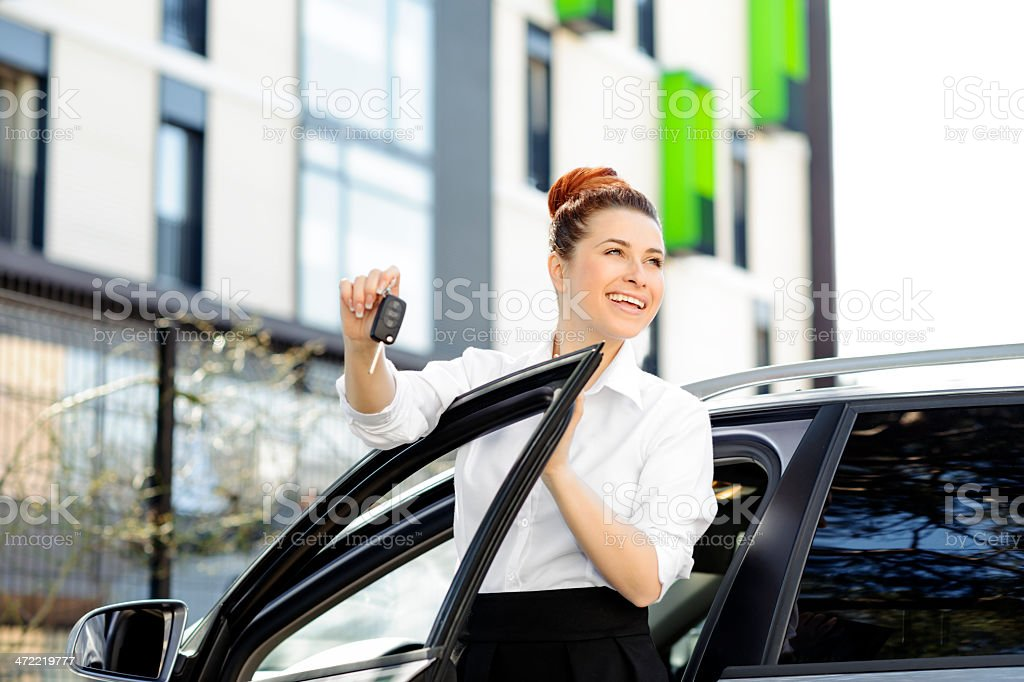 woman with car keys stock photo