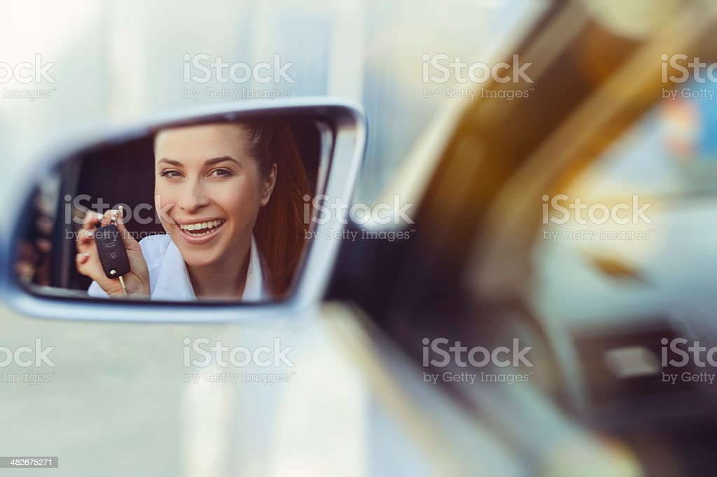 woman with car keys stock photo