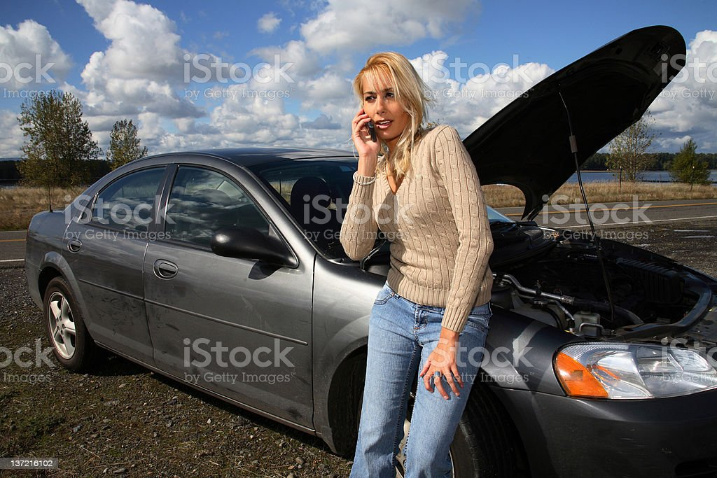 Woman with car trouble stock photo