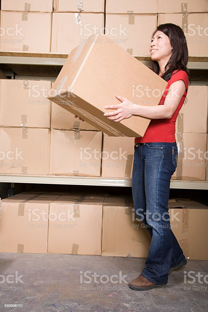 Woman with cardboard boxes stock photo