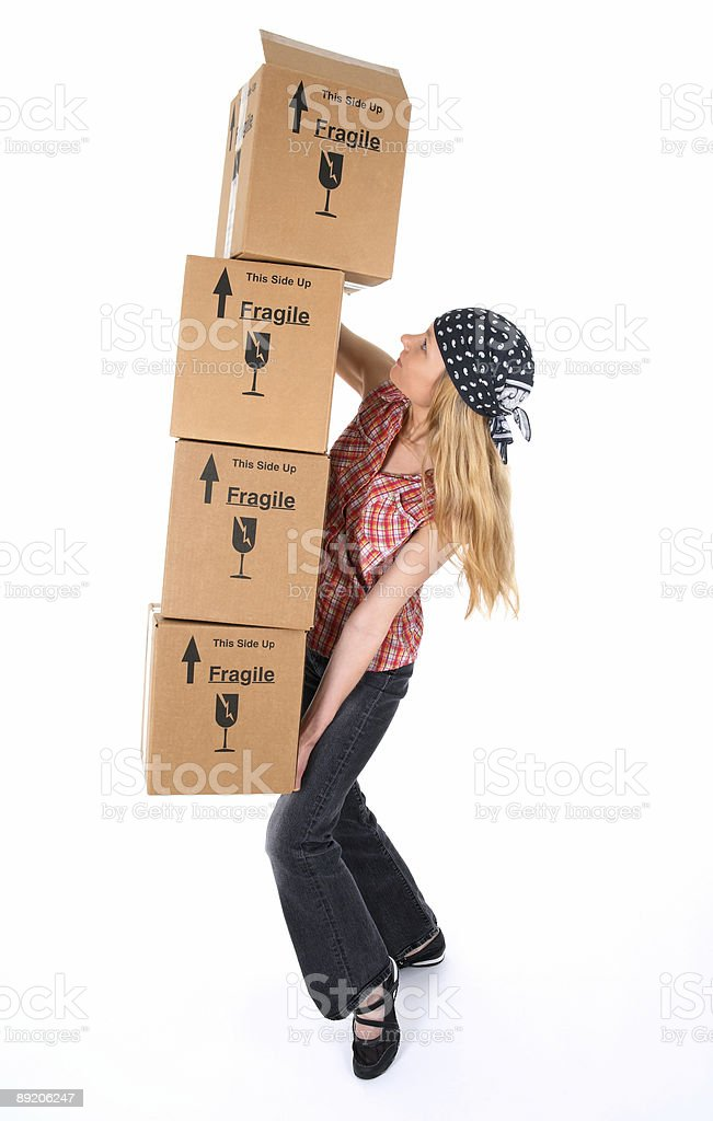 Woman with cardboard boxes ready to fall royalty-free stock photo