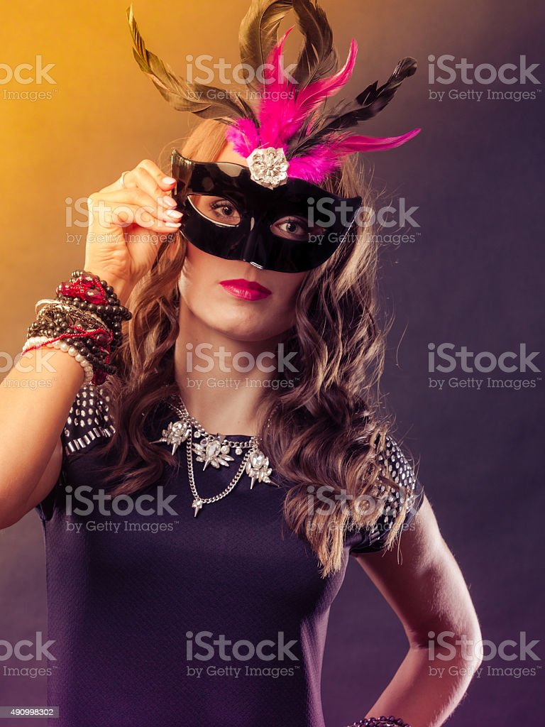 Woman with carnival venetian mask on dark stock photo