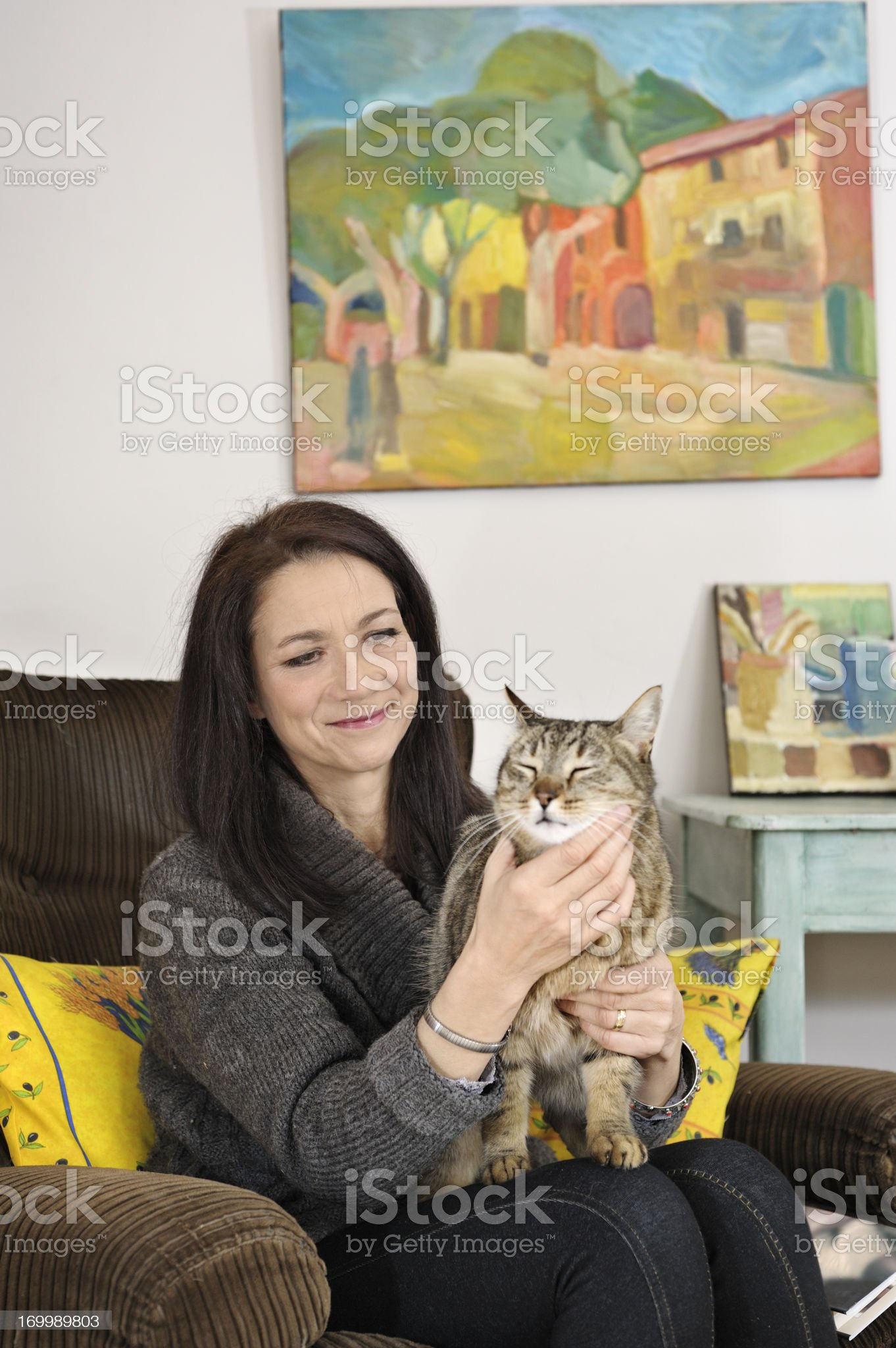 Woman with cat in living room royalty-free stock photo