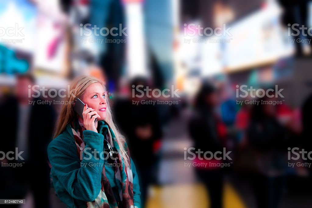 Woman with cell phone in Times Square, New York City. stock photo