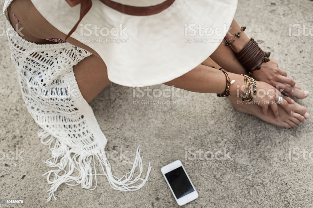 Woman with cell phone outdoors stock photo