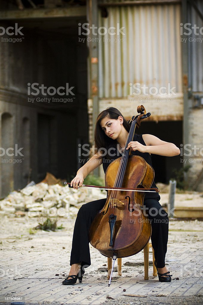 Woman with cello outdoors stock photo