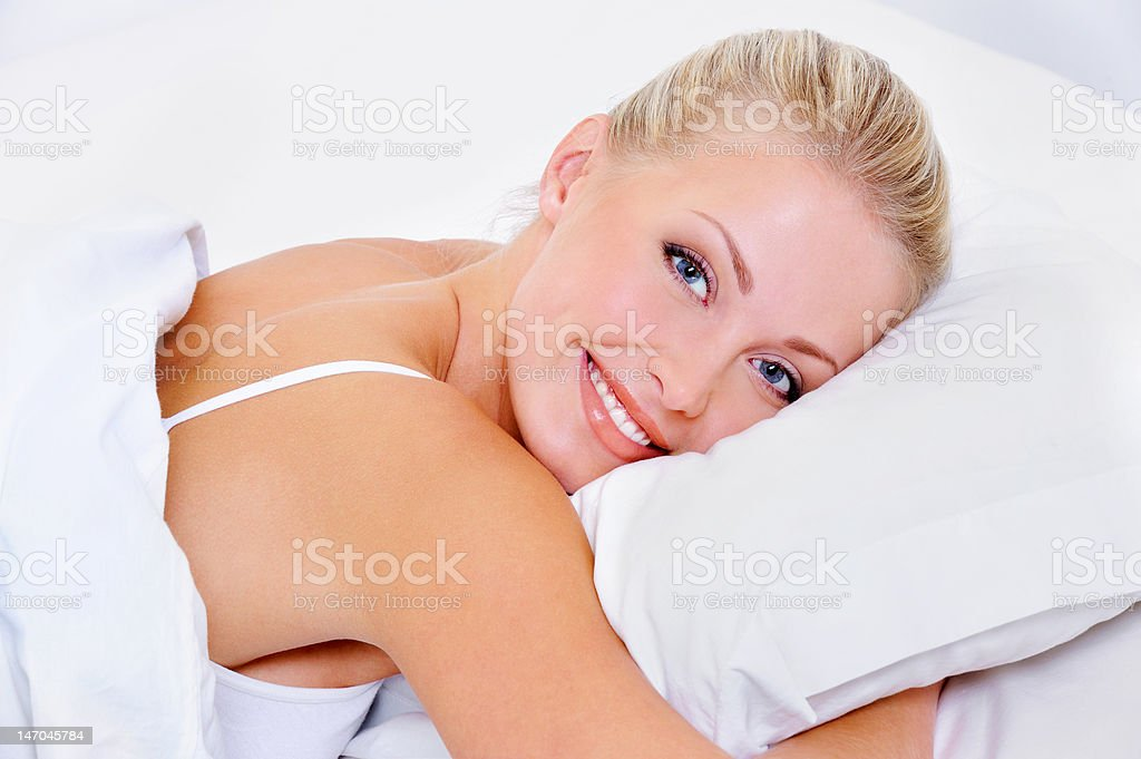 woman with charming smile after sleeping stock photo