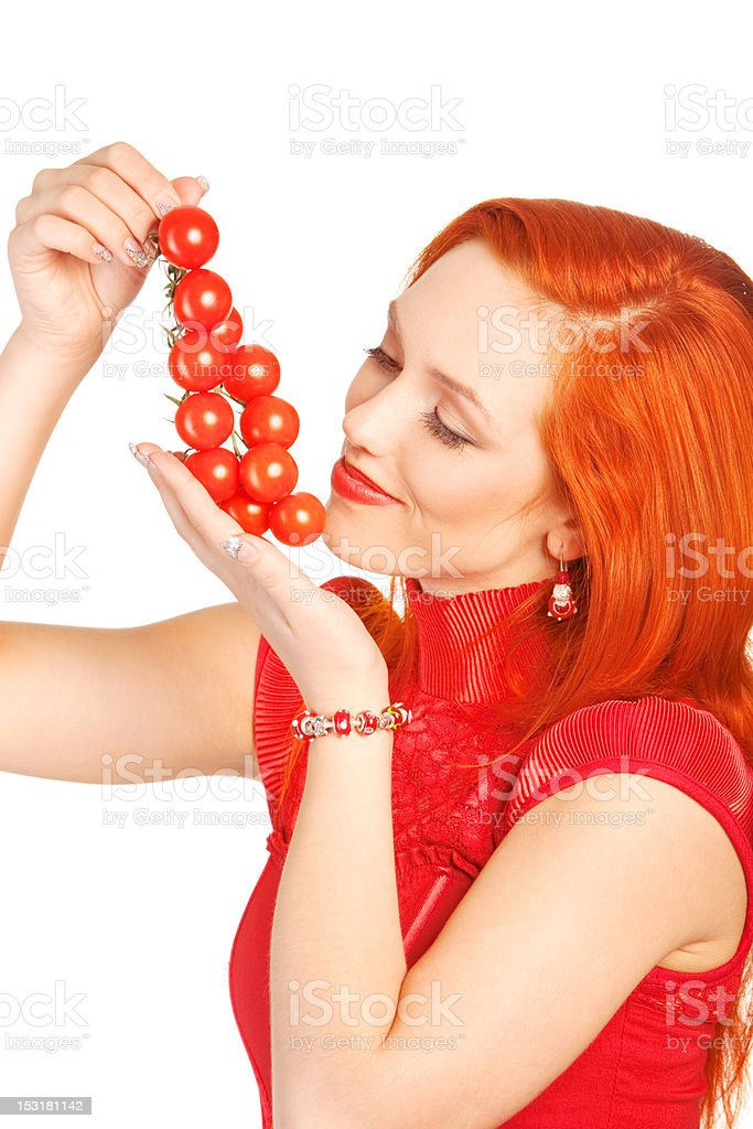 woman with cherry tomatoes royalty-free stock photo