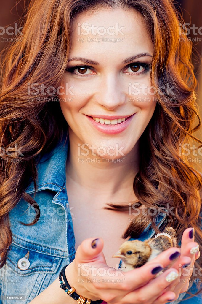 Woman with chicken stock photo