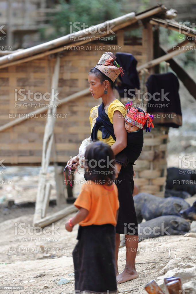 Woman with children-Akha Pala tribe-Pak Nam Noy area-Phongsali province-Laos. 3759 stock photo