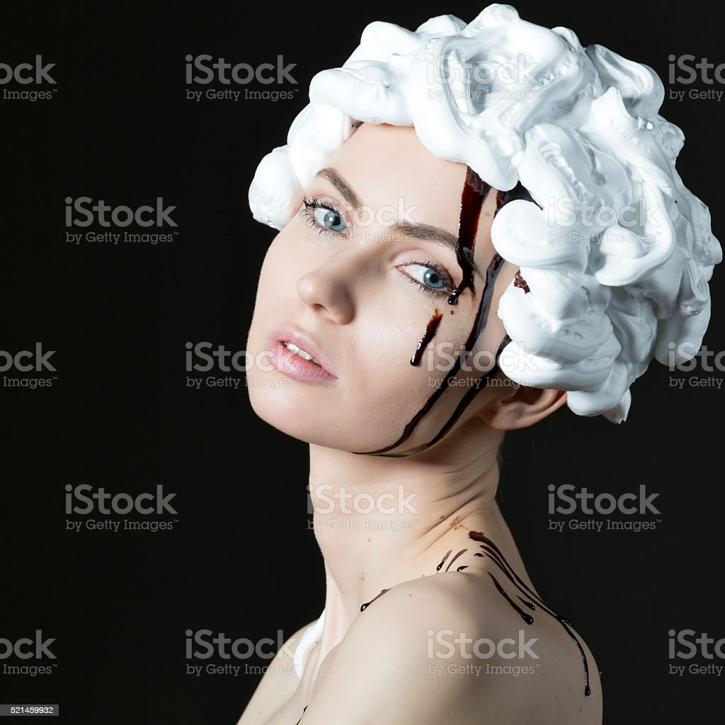 Woman with chocolate and white cream stock photo