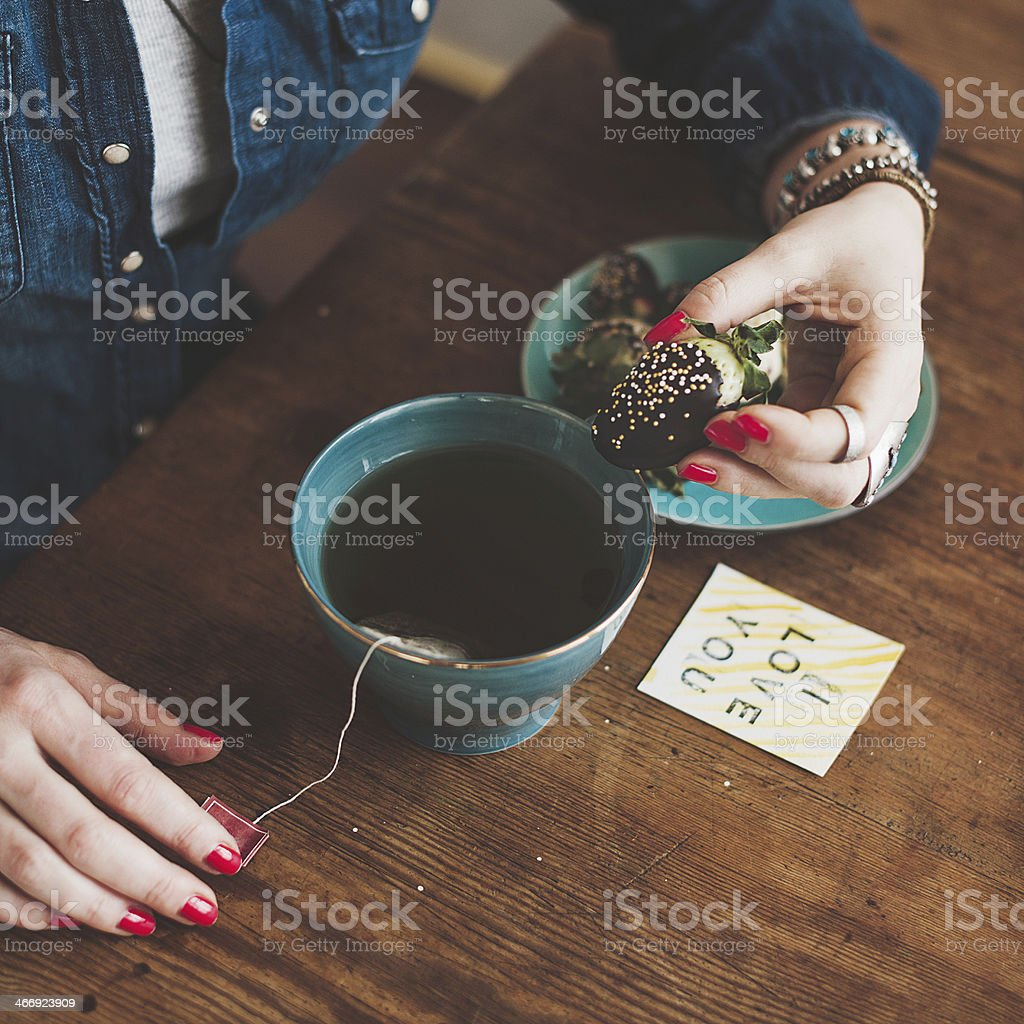Woman with chocolate dipped strawberry stock photo