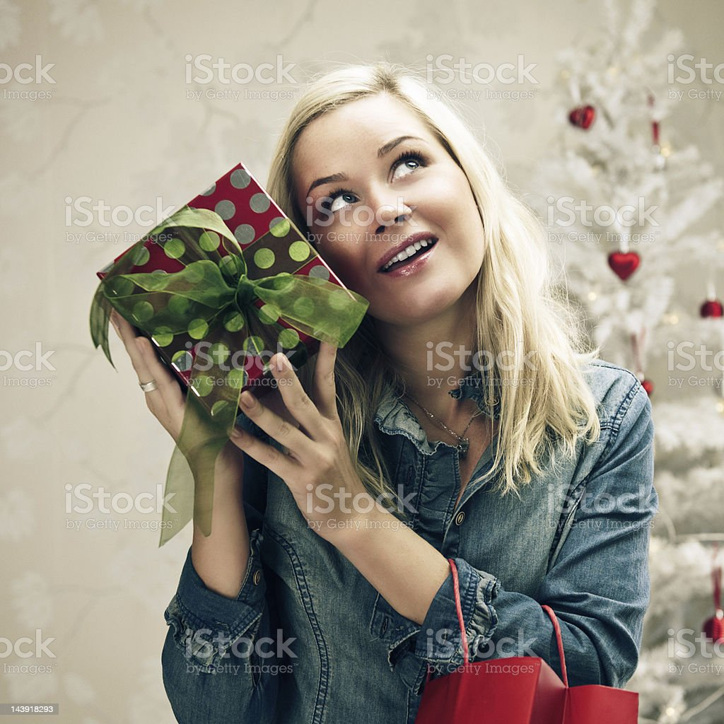 Woman with christmas gift royalty-free stock photo