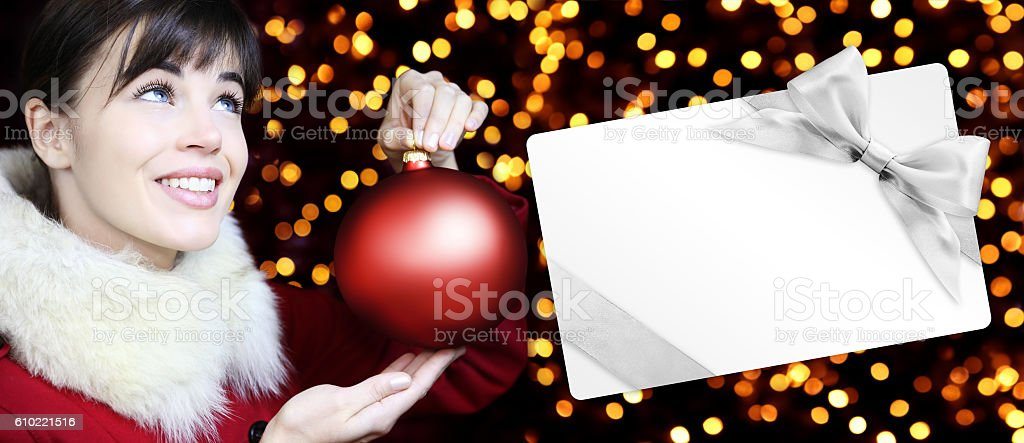 woman with christmas red ball and gift card stock photo