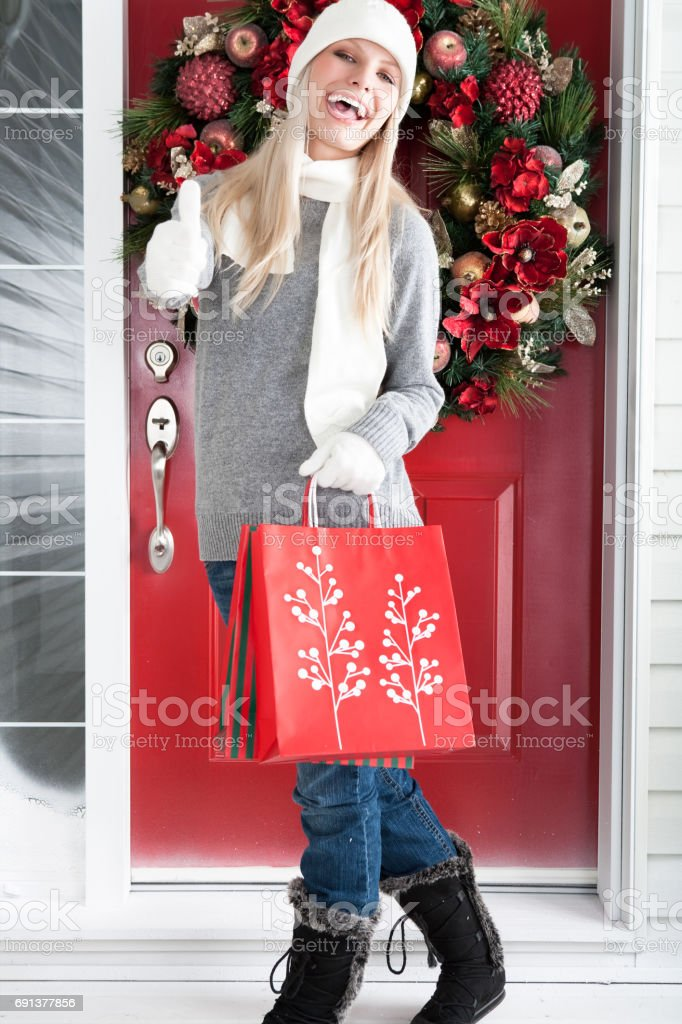 Woman with Christmas shopping bags stock photo