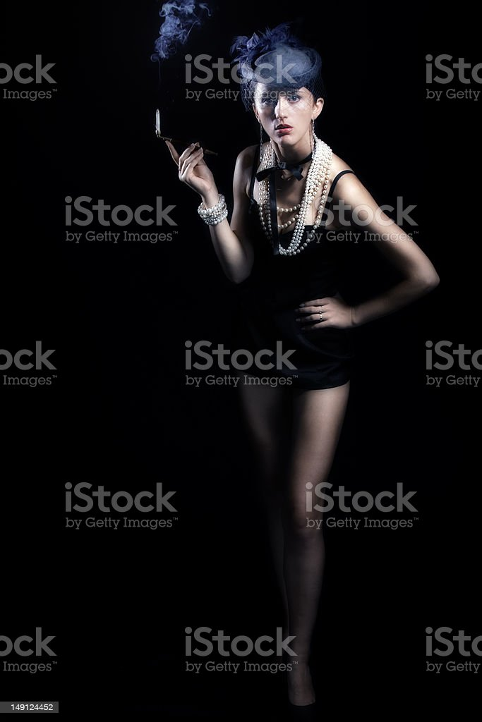 Woman with cigarette and long legs royalty-free stock photo