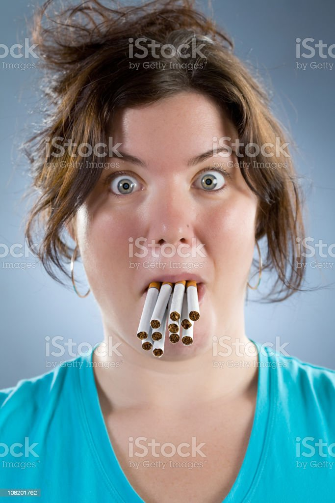 Woman with Cigarettes in Mouth royalty-free stock photo