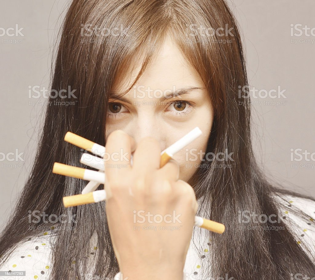 woman with cigarettes royalty-free stock photo
