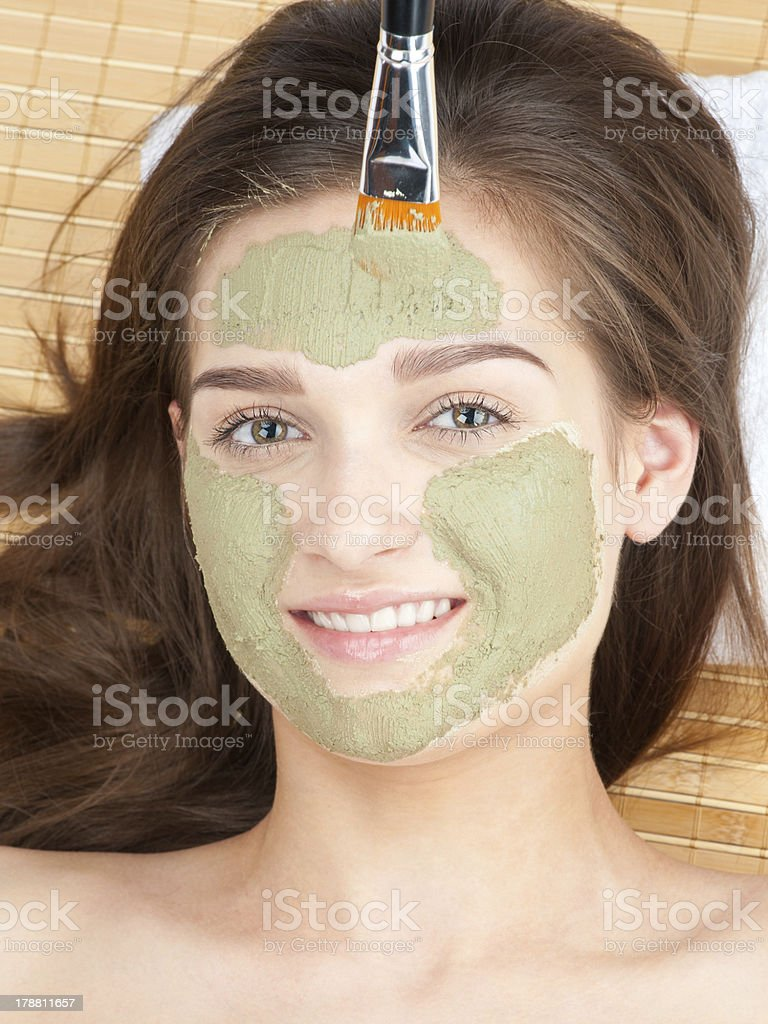 Woman with clay facial mask royalty-free stock photo