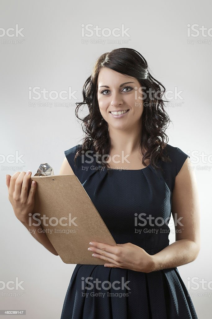 woman with clipboard stock photo