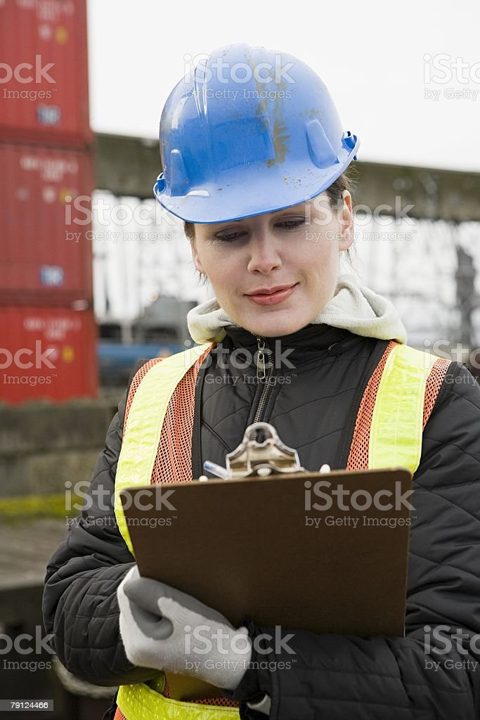 Woman with clipboard royalty-free stock photo