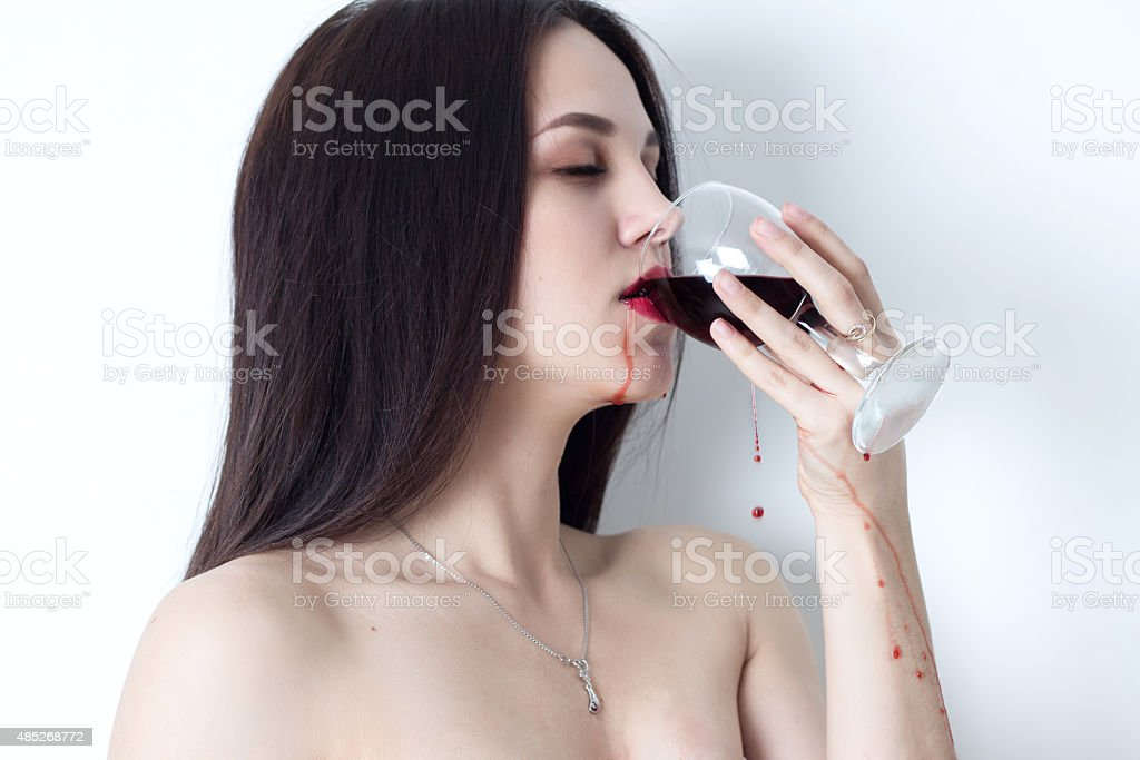 Woman with closed eyes drinking red wine stock photo