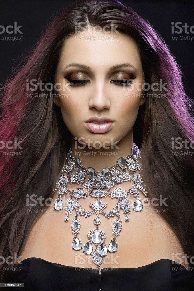 woman with closed  wearing necklace royalty-free stock photo