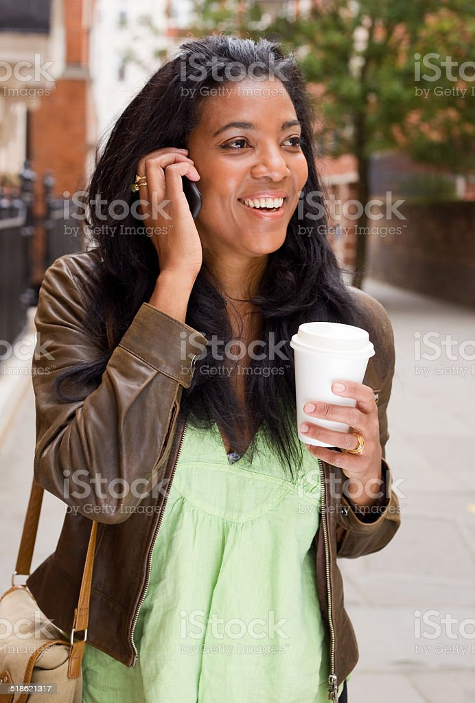 woman with coffee and phone royalty-free stock photo