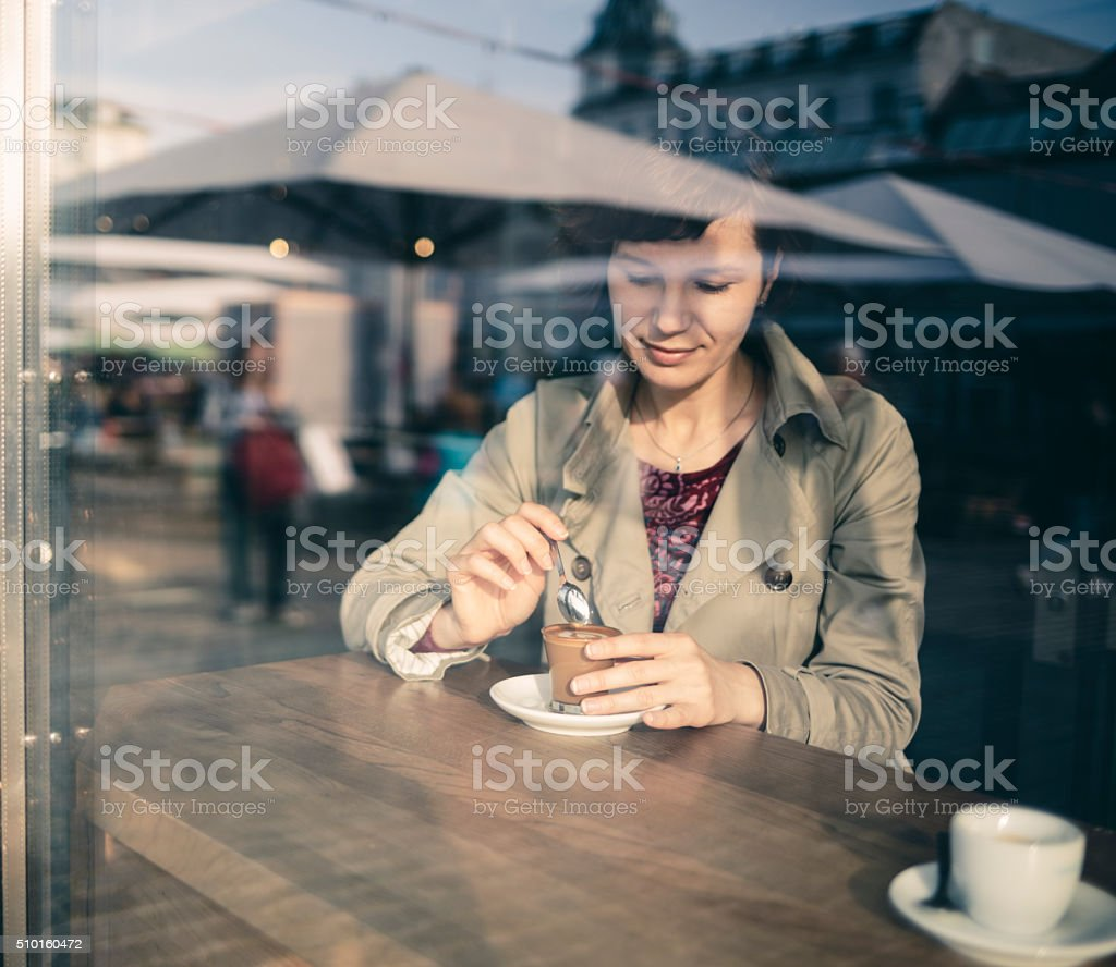 Woman with coffee in cafe in Copenhagen stock photo