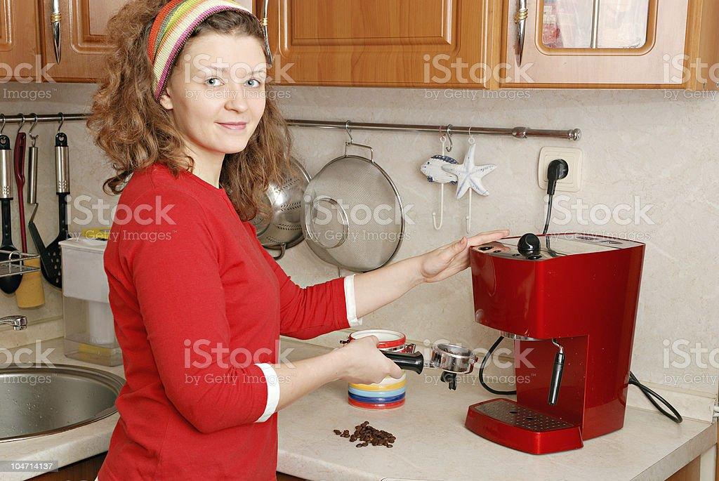 woman with coffee machine stock photo