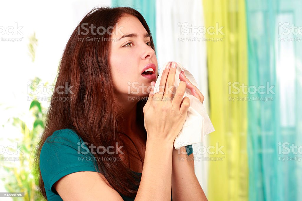 Woman with cold and handkerchief stock photo