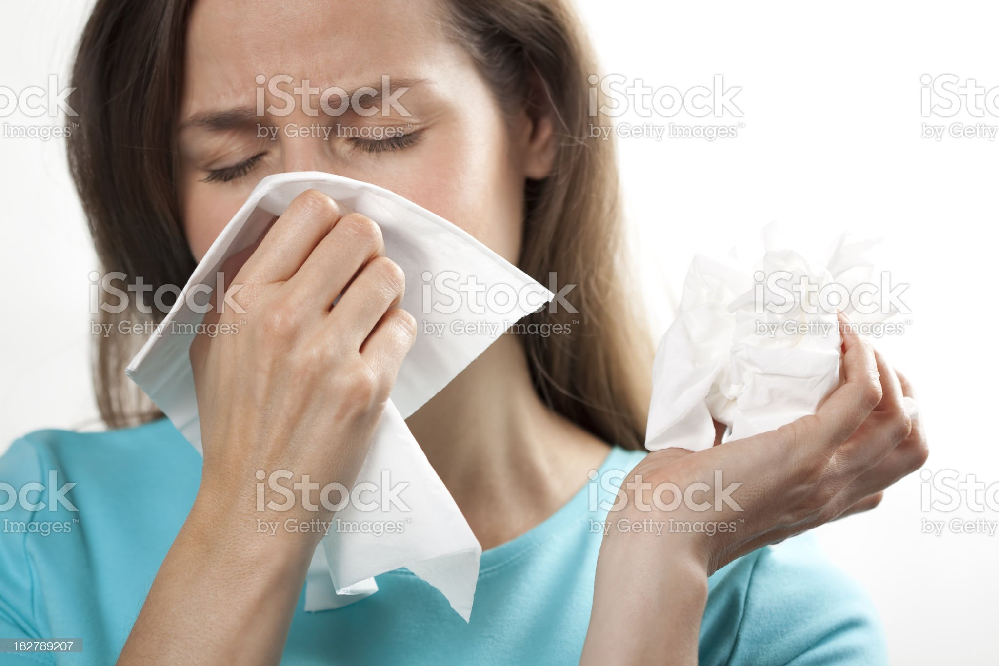 Woman with cold or flu and tissues royalty-free stock photo