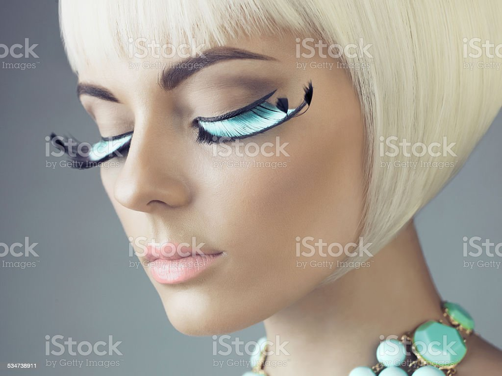 Woman with color eyelashes stock photo